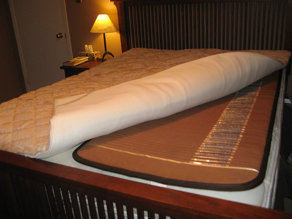 Professional Biomat on bed with Queen Sized Quantum Energy pad